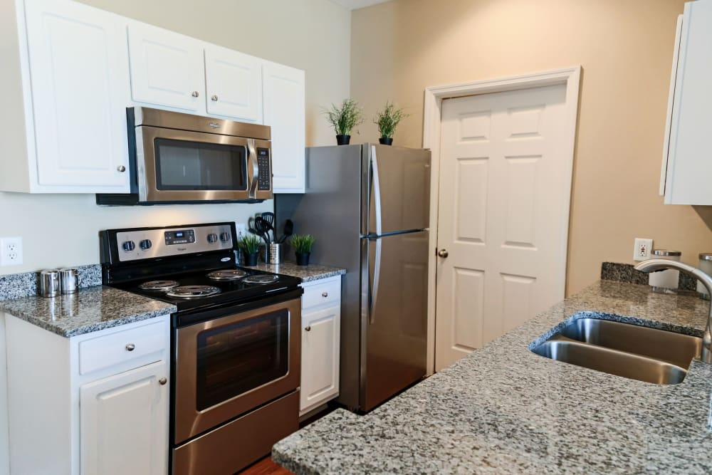 Kitchen with granite style counter tops at The Preserve at Beckett Ridge Apartments & Townhomes in West Chester, Ohio
