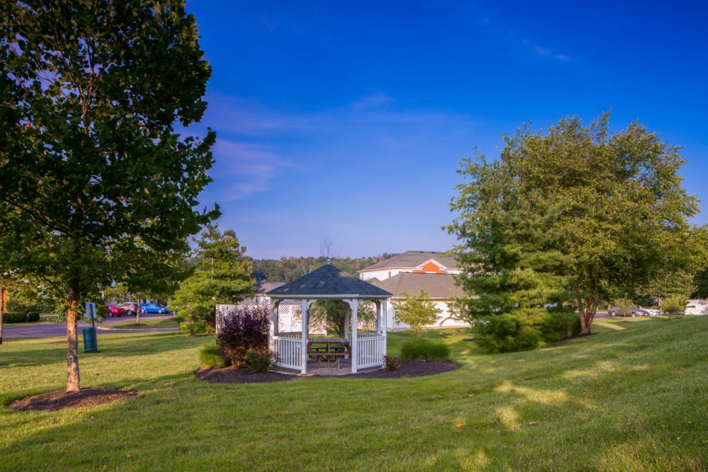 Large community lawn with gazebo at The Preserve at Beckett Ridge Apartments & Townhomes in West Chester, Ohio