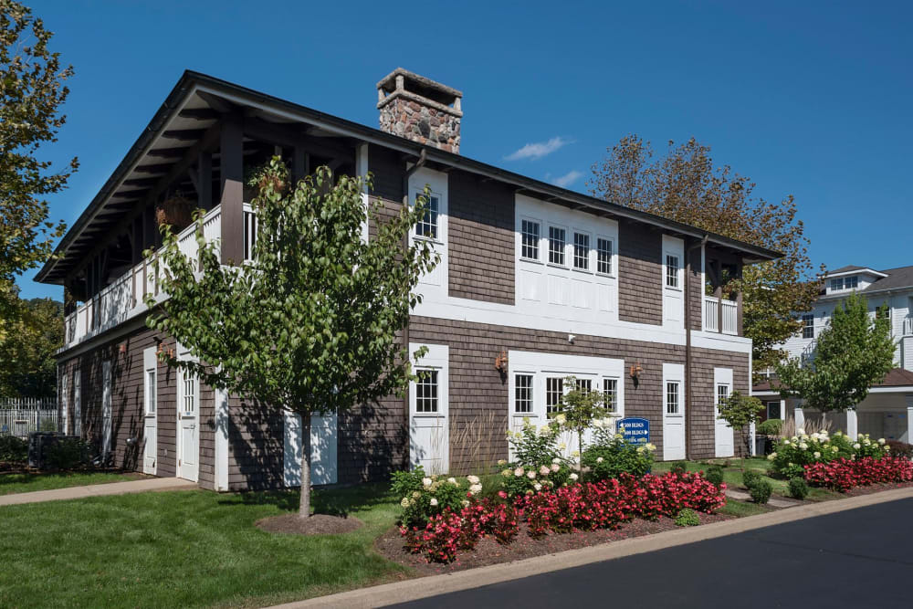 Pretty garden and lawn in front of The Waterfront Apartments & Townhomes in Munhall, Pennsylvania