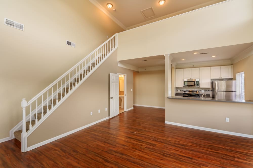 Stairs to loft area from living room at The Waterfront Apartments & Townhomes in Munhall, Pennsylvania