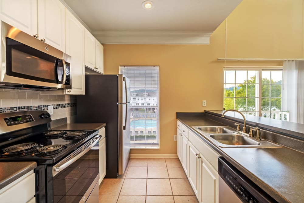 Kitchen with tile floors at The Waterfront Apartments & Townhomes in Munhall, Pennsylvania