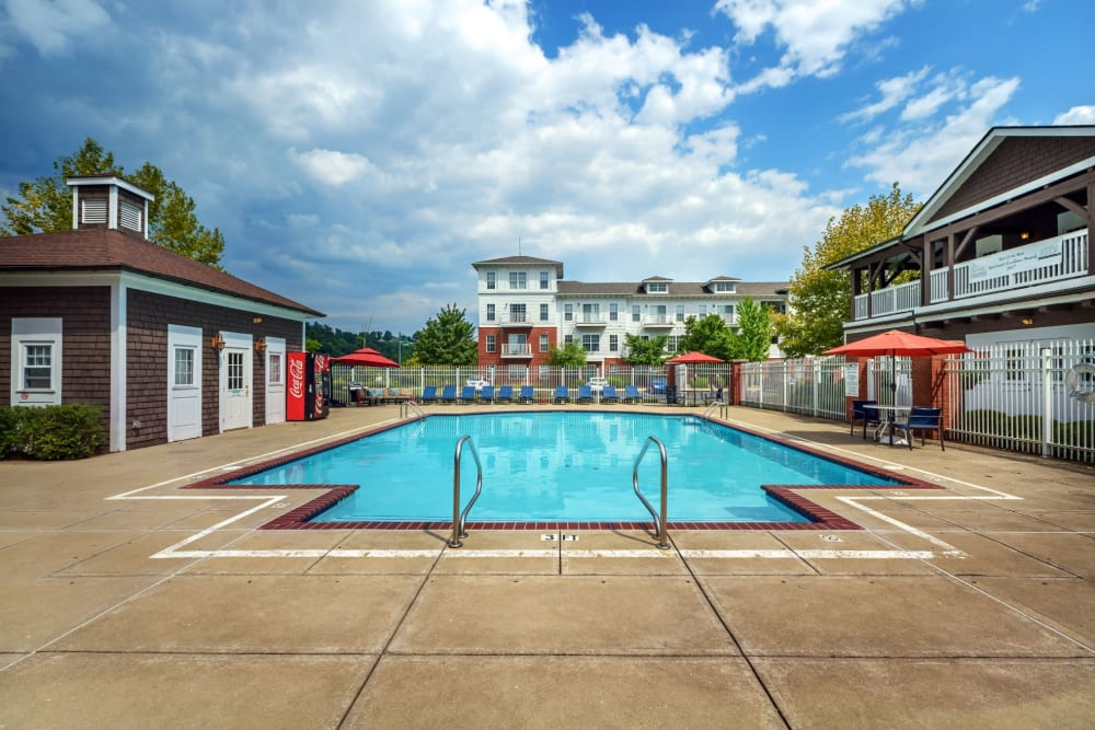 Swimming pool and outdoor seating around at The Waterfront Apartments & Townhomes in Munhall, Pennsylvania