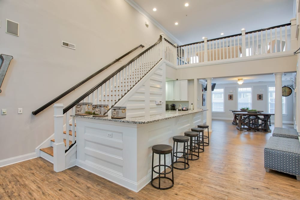 Large bar in clubhouse with plenty of seats at Worthington Apartments & Townhomes in Charlotte, North Carolina