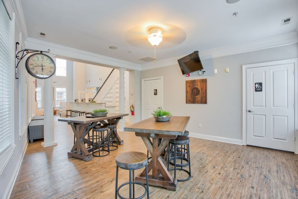 Tables to sit at in the clubhouse at Worthington Apartments & Townhomes in Charlotte, North Carolina