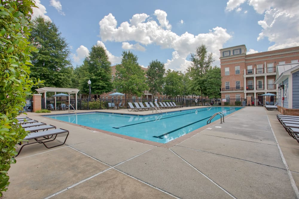 In Charlotte, North Carolina at the pool with ample seating for residents at Worthington Apartments & Townhomes