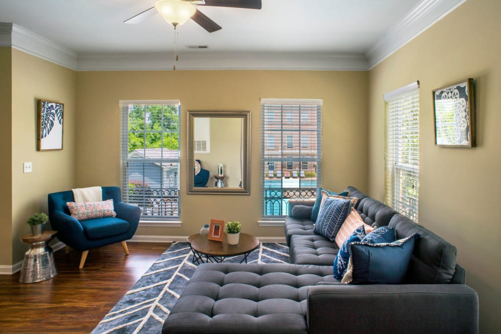 Living room with large windows to bring in lots of natural light at Worthington Apartments & Townhomes in Charlotte, North Carolina