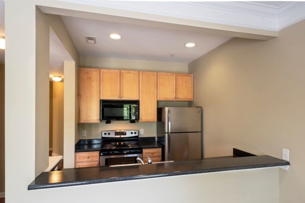 Kitchen with light wood cabinets at Worthington Apartments & Townhomes in Charlotte, North Carolina