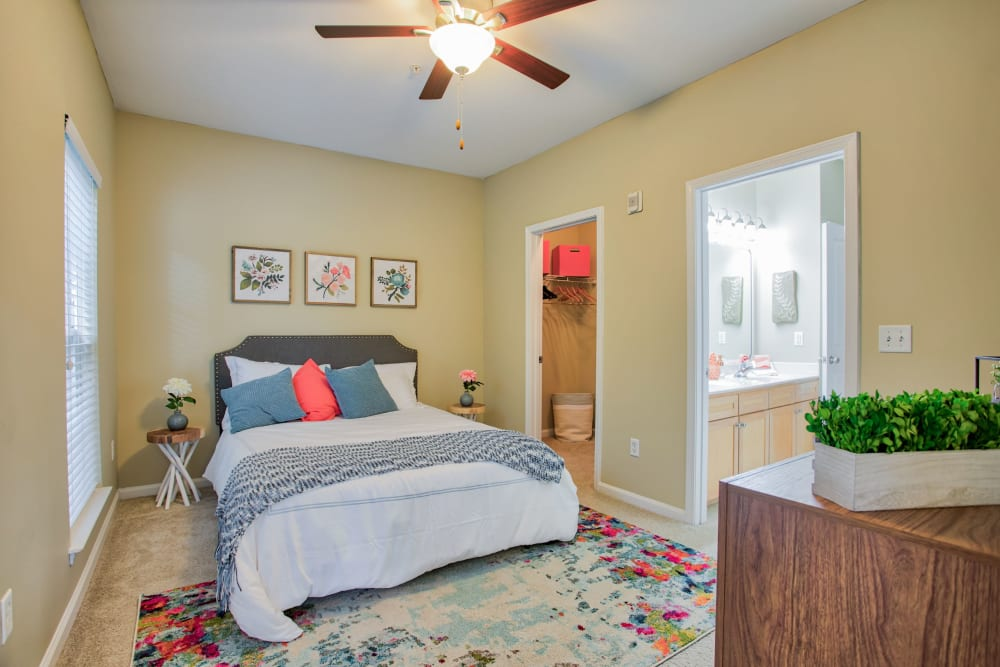 Bedroom with ceiling fan and walk in closet at Worthington Apartments & Townhomes in Charlotte, North Carolina