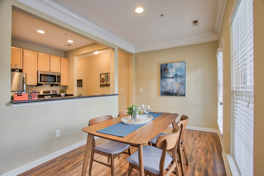 Dining area with wooden table at Worthington Apartments & Townhomes in Charlotte, North Carolina