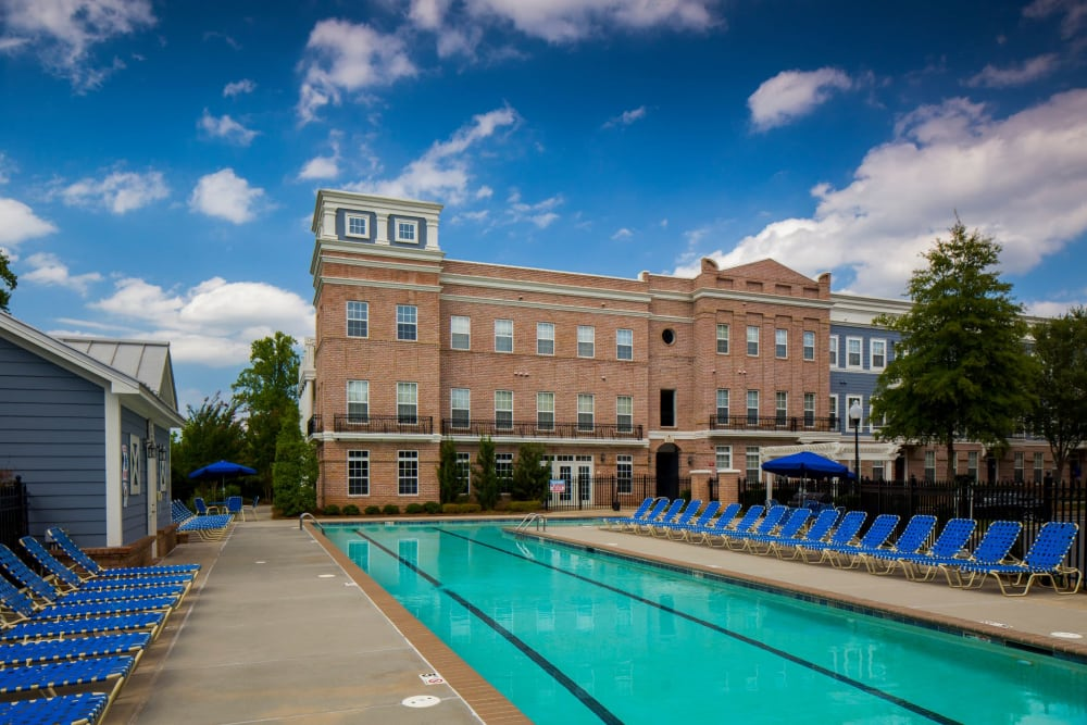 Large pool with lots of seating at Worthington Apartments & Townhomes in Charlotte, North Carolina
