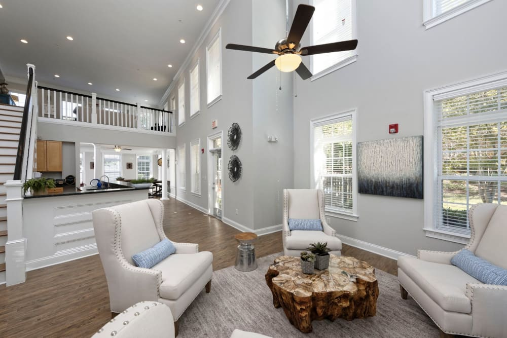 Hang out at the clubhouse with large ceiling fans at Worthington Apartments & Townhomes in Charlotte, North Carolina