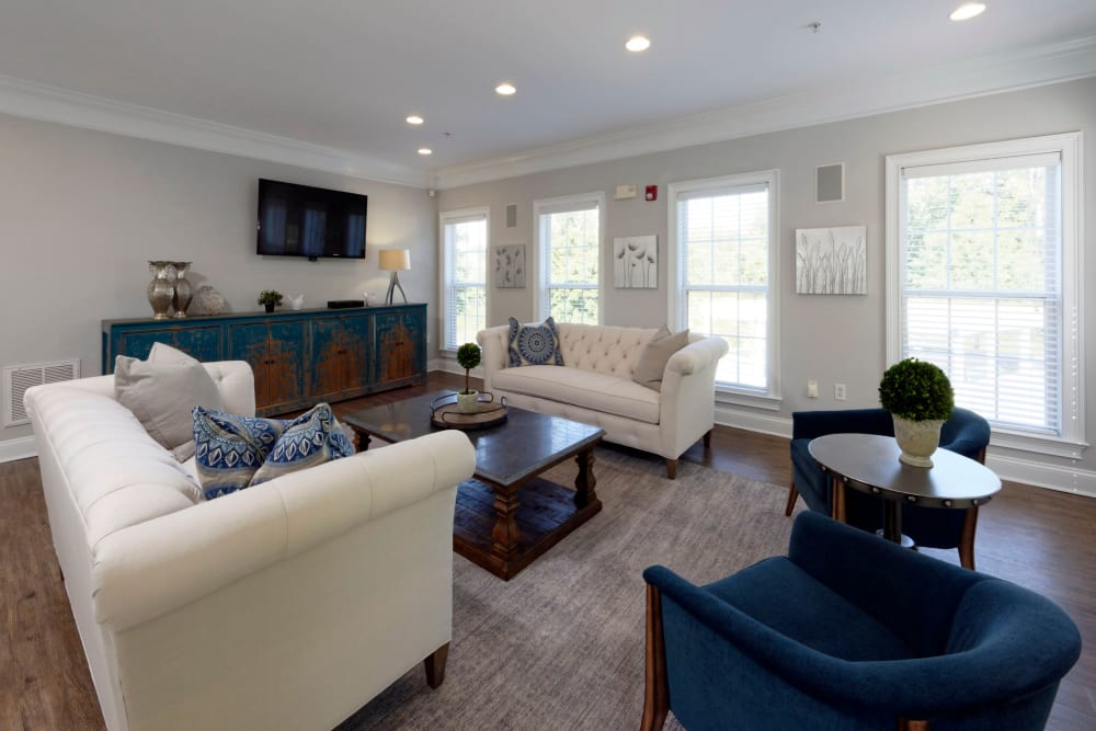Relax at the clubhouse in one of the couches or chairs at Worthington Apartments & Townhomes in Charlotte, North Carolina