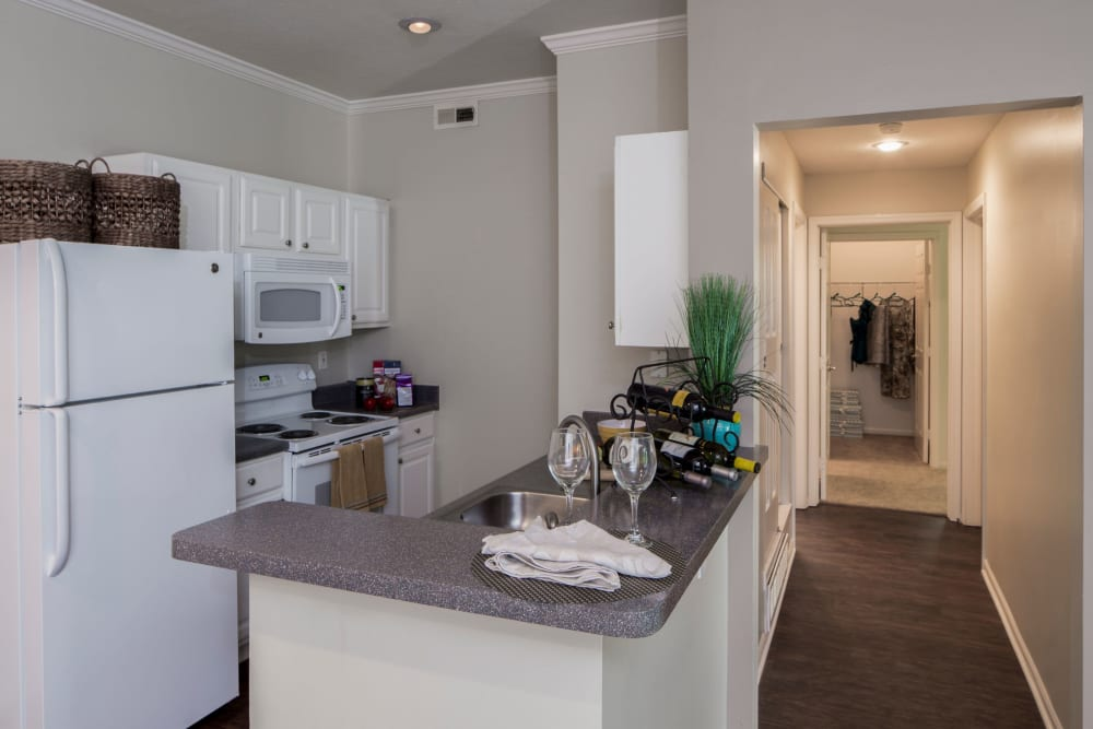 Kitchen and breakfast bar at The Woods at Polaris Parkway Apartments & Townhomes in Westerville, Ohio