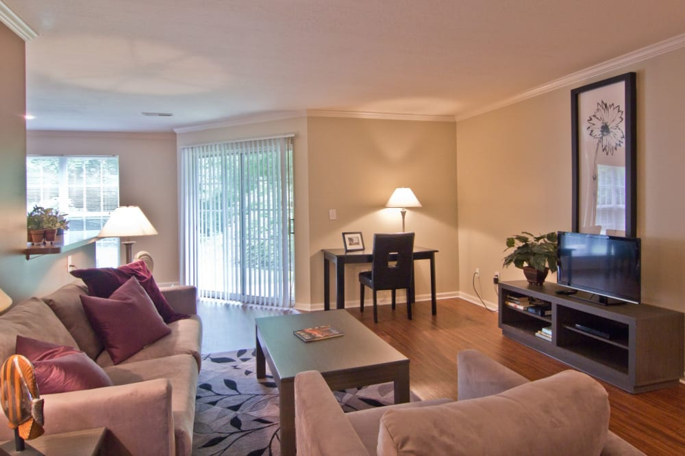 Living room with wood style flooring at The Woods at Polaris Parkway Apartments & Townhomes in Westerville, Ohio
