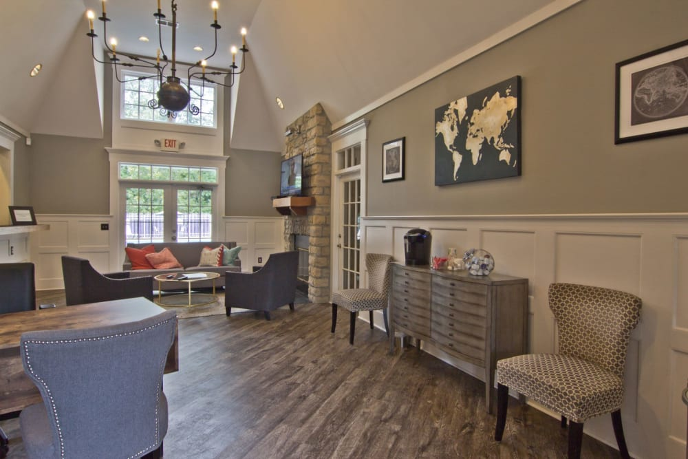 Hangout inside the clubhouse by the pool at The Woods at Polaris Parkway Apartments & Townhomes in Westerville, Ohio
