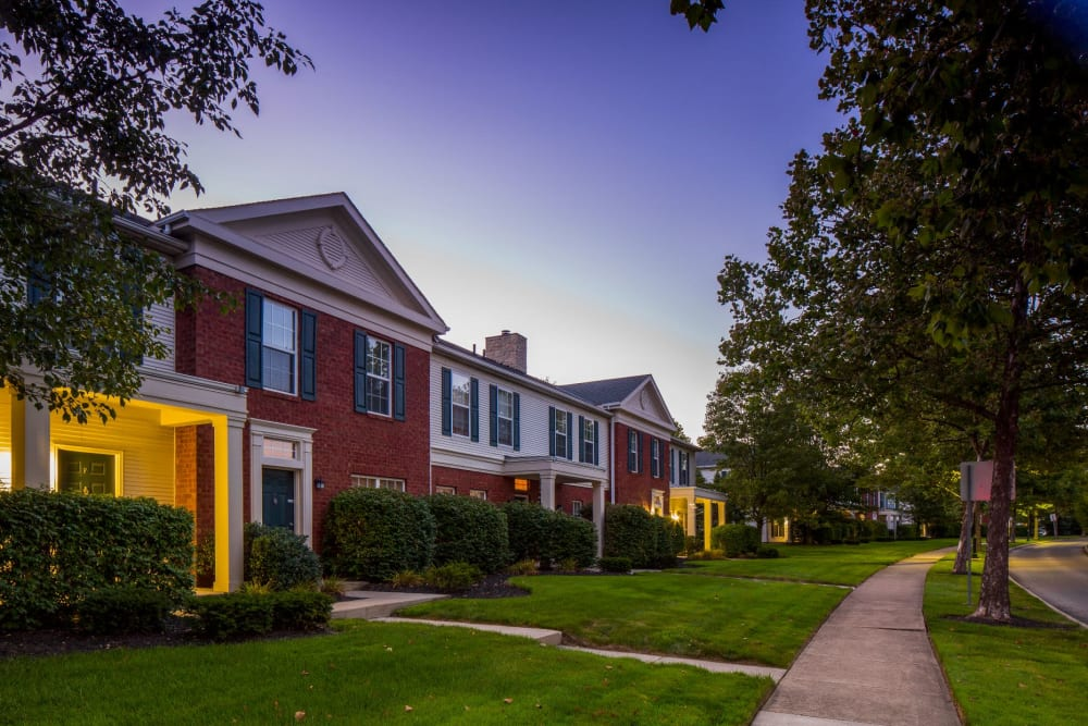 Outside The Woods at Polaris Parkway Apartments & Townhomes on the green grass in Westerville, Ohio