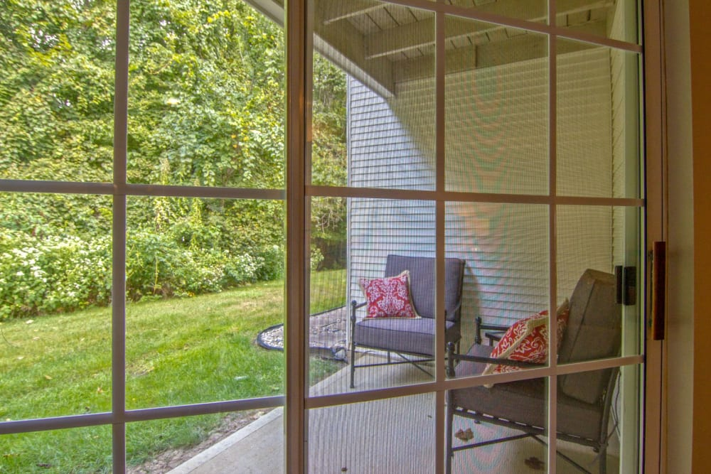 Large window sliding door to private patio at The Woods at Polaris Parkway Apartments & Townhomes in Westerville, Ohio