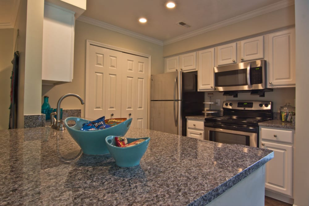 Lots of kitchen counter space to cook on at The Woods at Polaris Parkway Apartments & Townhomes in Westerville, Ohio