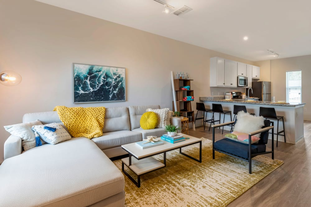 Bright living room at UNCOMMON Wilmington in Wilmington, North Carolina