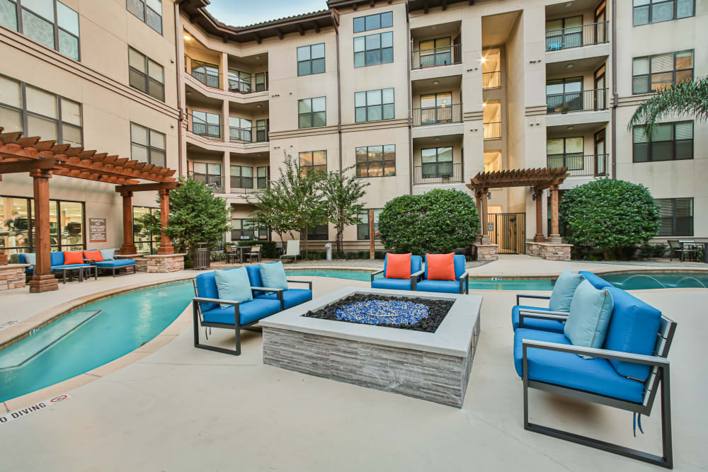 Fire pit by pool at Broadstone Toscano in Houston, Texas