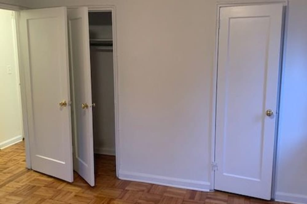Bedroom with closet for storage at King Alfred Apartments in Passaic, New Jersey