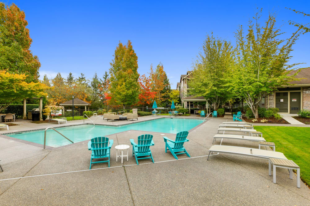 A hot tub surrounded by lush landscaping at The Grove at Orenco Station in Hillsboro, Oregon