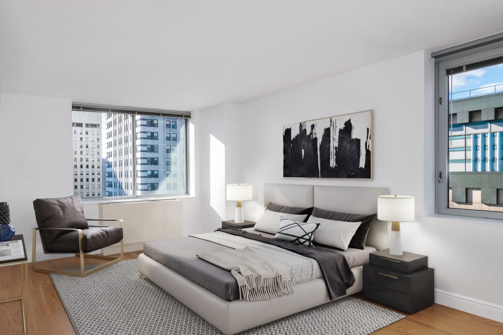 A spacious bedroom with large windows at The Metropolis in New York, New York