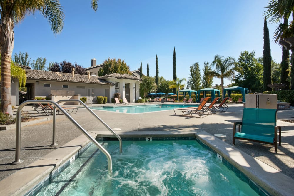 Swimming pool with cabanas and lounge chairs at Miramonte and Trovas in Sacramento, California