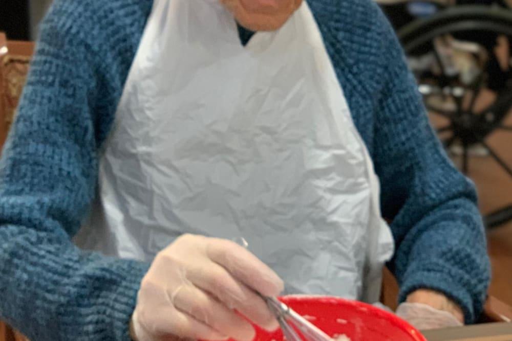 Resident making food at Regent Court Senior Living