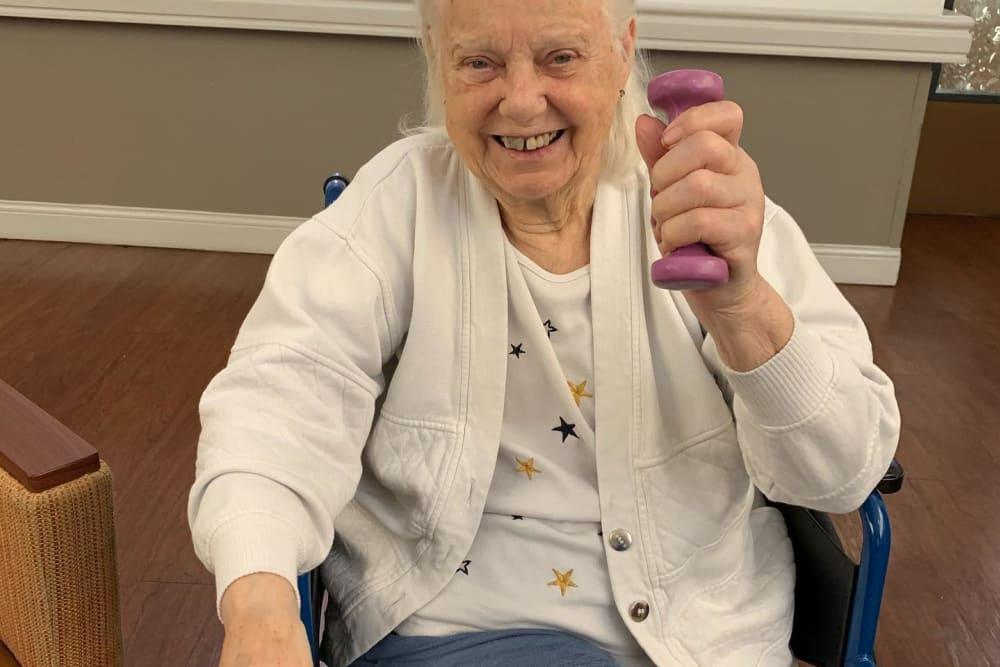Elderly woman lifting weights at Regent Court Senior Living