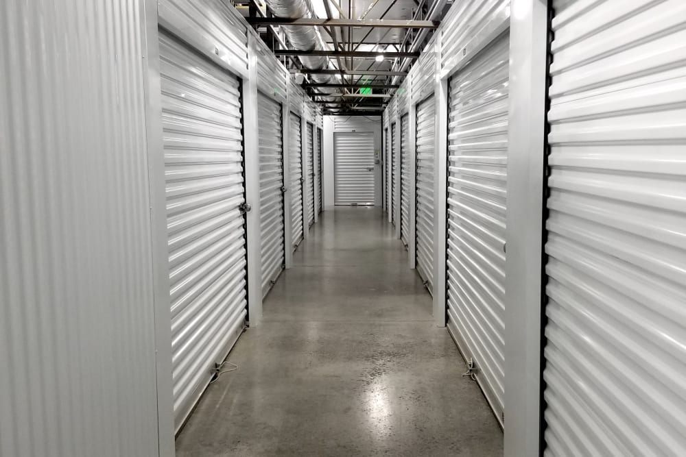 Row of indoor storage units at Global Self Storage in McCordsville, Indiana
