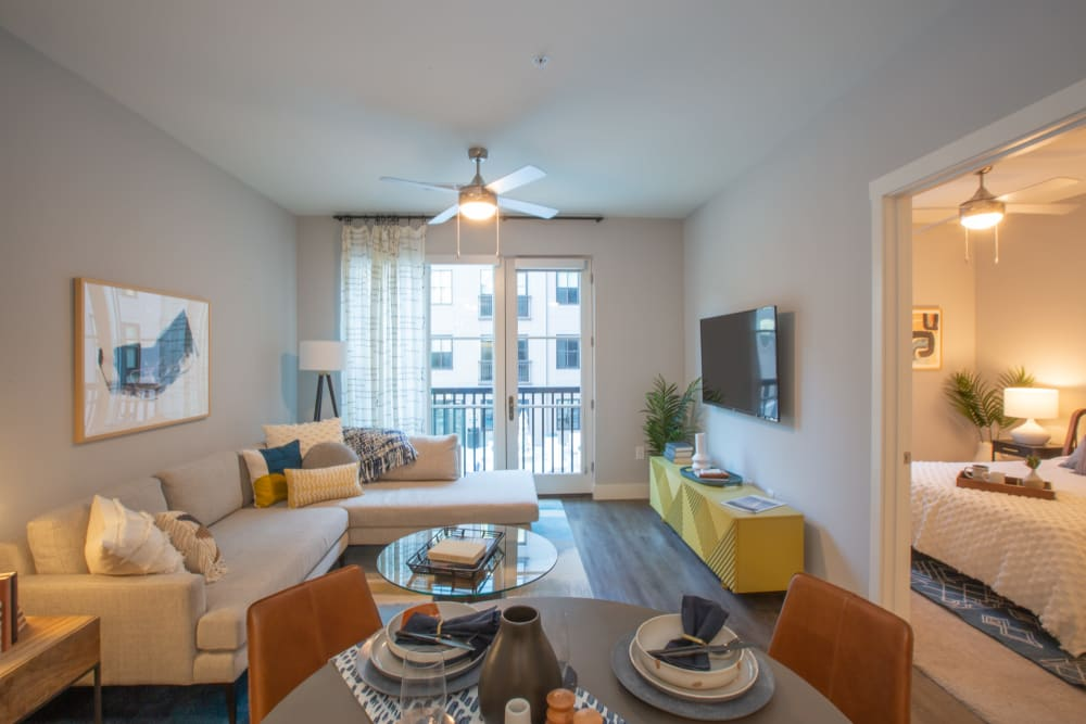 Living room with patio access and a ceiling fan at 511 Meeting in Charleston, South Carolina