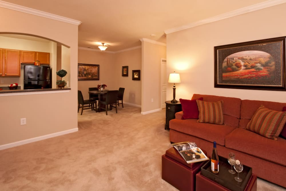 A spacious living room next to the dining room at Meridian Watermark in North Chesterfield, Virginia