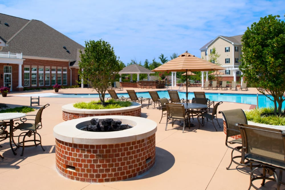 A firepit surround by table and chairs at Meridian Watermark in North Chesterfield, Virginia