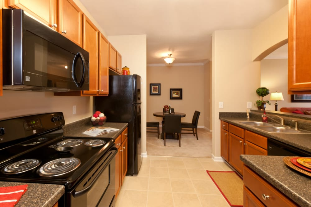 A kitchen with black appliances at Meridian Watermark in North Chesterfield, Virginia