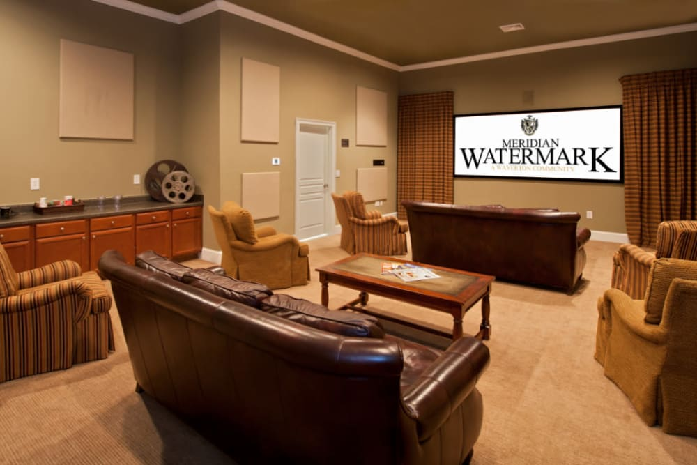 A community theater with comfortable seating at Meridian Watermark in North Chesterfield, Virginia
