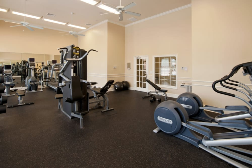 A fitness center with plenty of workout stations at Meridian Watermark in North Chesterfield, Virginia