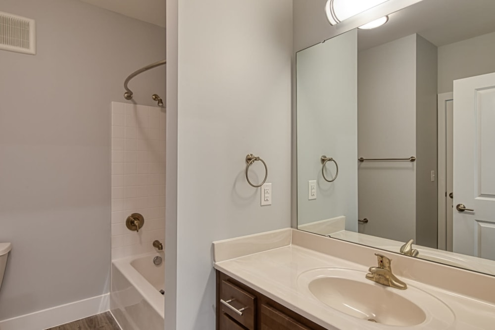 A bathroom with a large vanity mirror at Marina Villa in Norfolk, Virginia