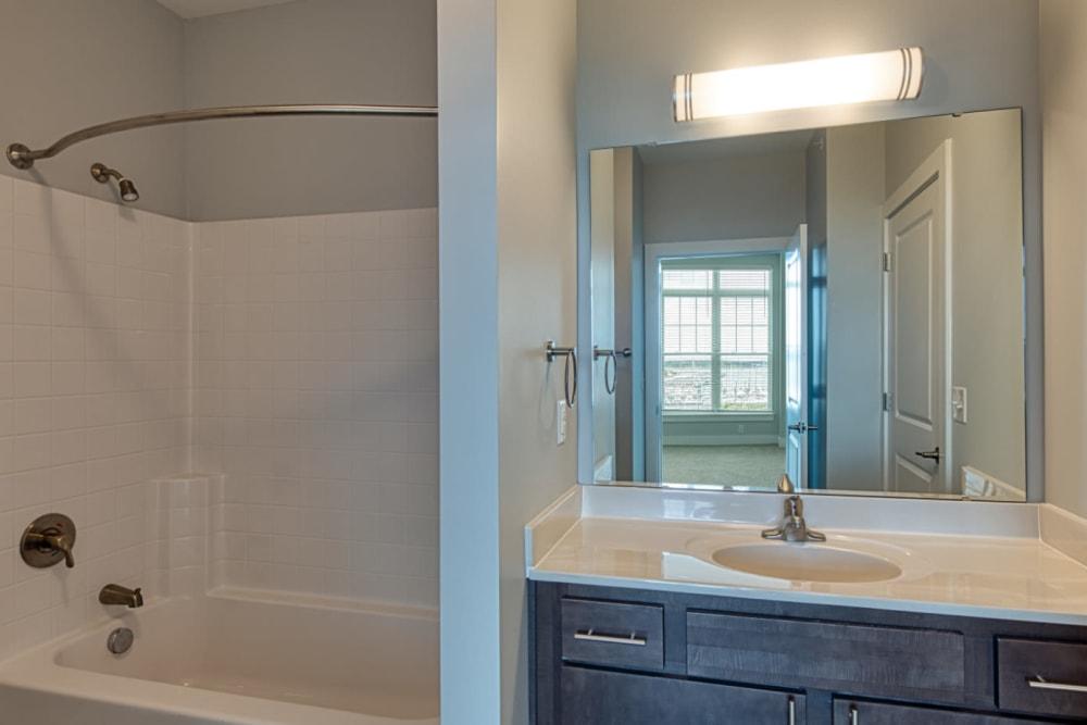 A bathroom with an oval tub at Marina Villa in Norfolk, Virginia