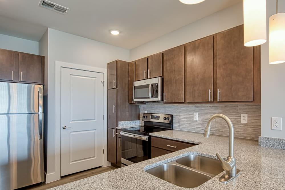 A kitchen with stainless-steel appliances at Marina Villa in Norfolk, Virginia