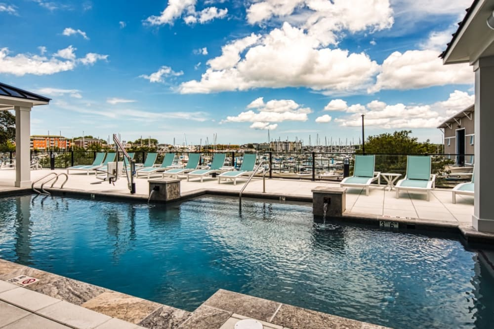 A swimming pool with a view of the harbor at Marina Villa in Norfolk, Virginia