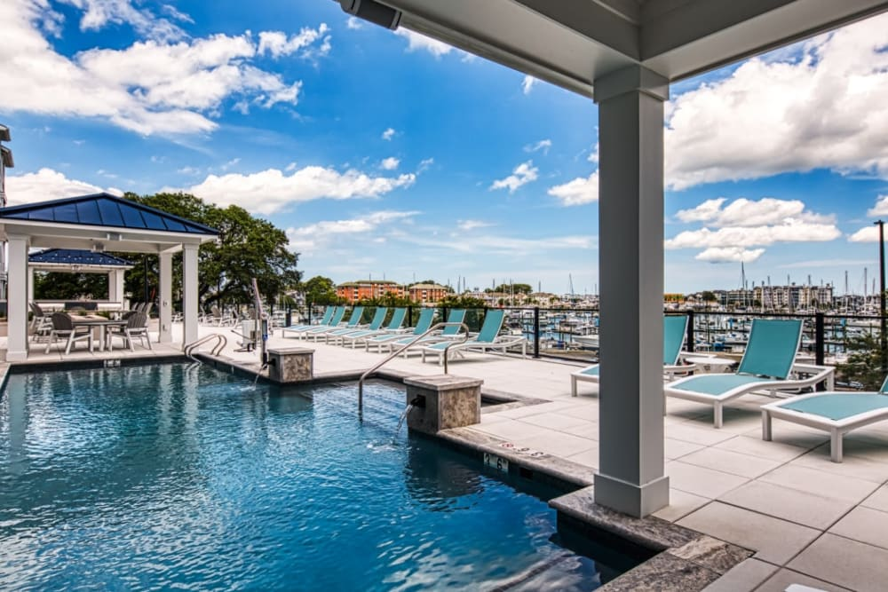 A swimming pool with an expansive sundeck at Marina Villa in Norfolk, Virginia