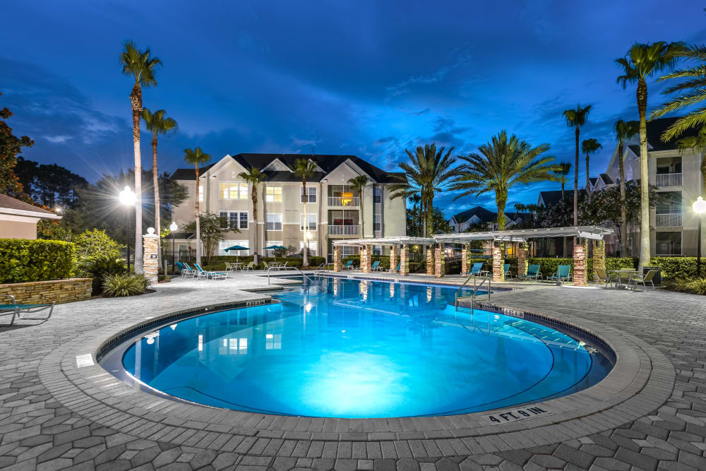 Beautiful pool at night in Jacksonville, Florida at Eddison at Deerwood Park