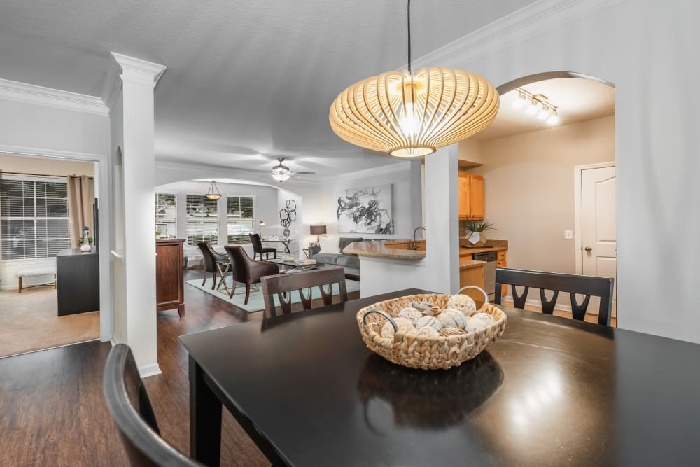 Modern dining room and kitchen at Eddison at Deerwood Park in Jacksonville, Florida
