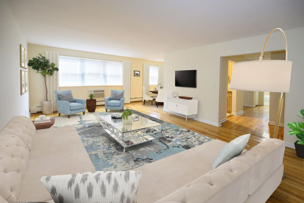 Spacious living room in a model home at Kennedy Apartments in Hackensack, New Jersey