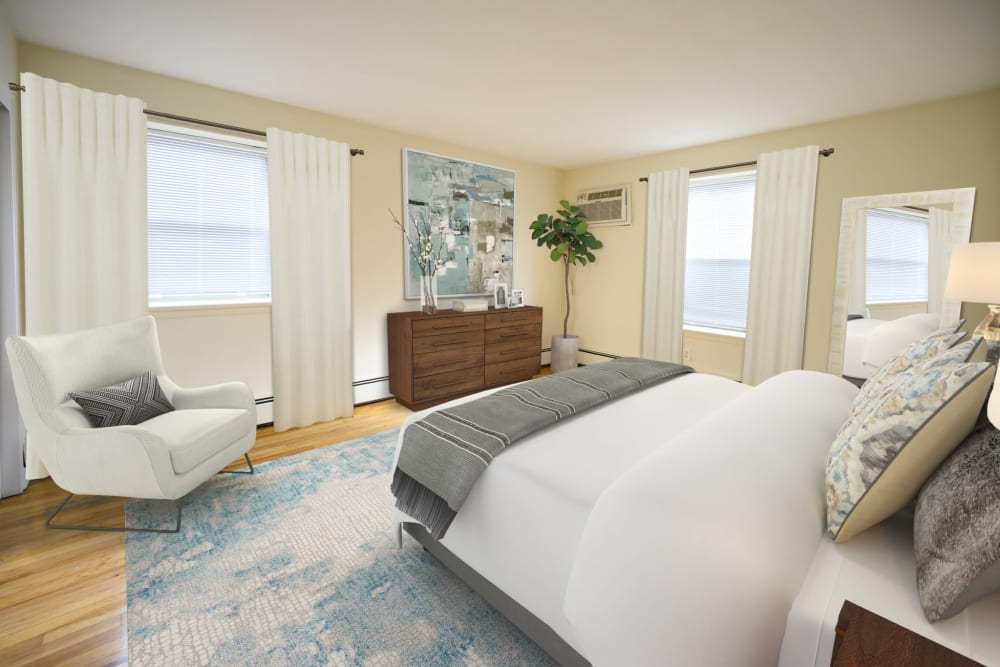 Furnished bedroom with tons of natural light at Kennedy Apartments in Hackensack, New Jersey