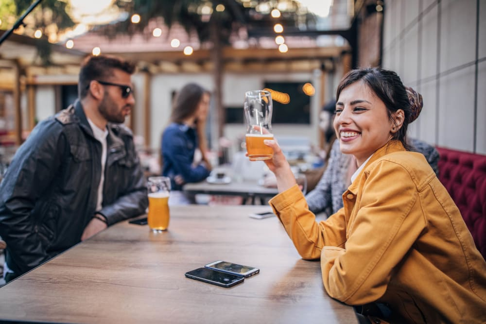 Couple enjoying beers in Cambridge, Maryland near Crusader Arms Apartments
