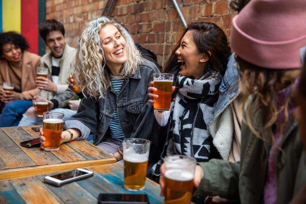 Friends enjoying a beer in Laurel, Delaware near Hollybrook Farms Apartments
