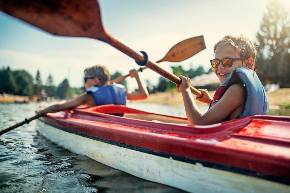 Two kids kayaking in Laurel, Delaware near Hollybrook Farms Apartments