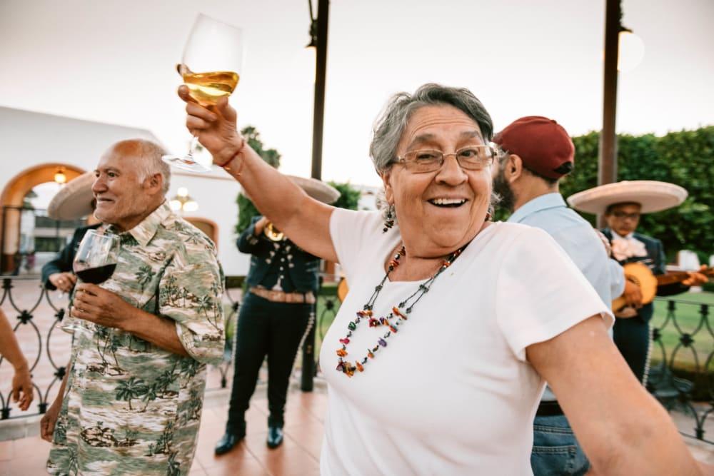 Woman enjoying wine and dancing in Rising Sun, Maryland near Fairview Senior Apartments